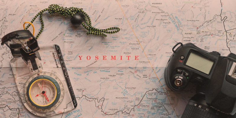 Compass and camera on map of Yosemite National Park