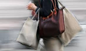 Woman with three bags going to work