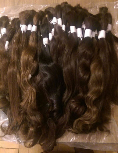Image of large bundle of virgin Indian bulk(loose) hair in various shades of brown.
