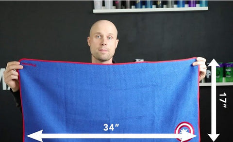 Performa owner Mark Holowaychuk holding up a Performance Towel to show how big they are
