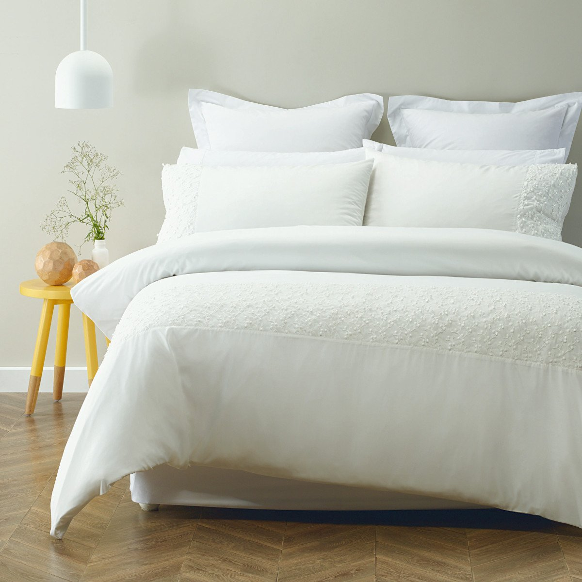 Appliqued soft feel polyester duvet cover set. Ivory quilt cover set.