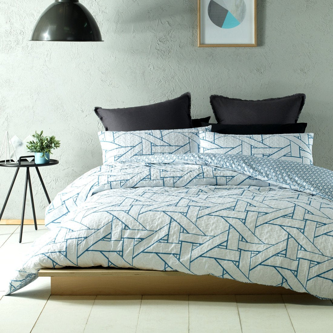 Reversible, Minimal, understated colors like white and blue feature on this quilt cover set.