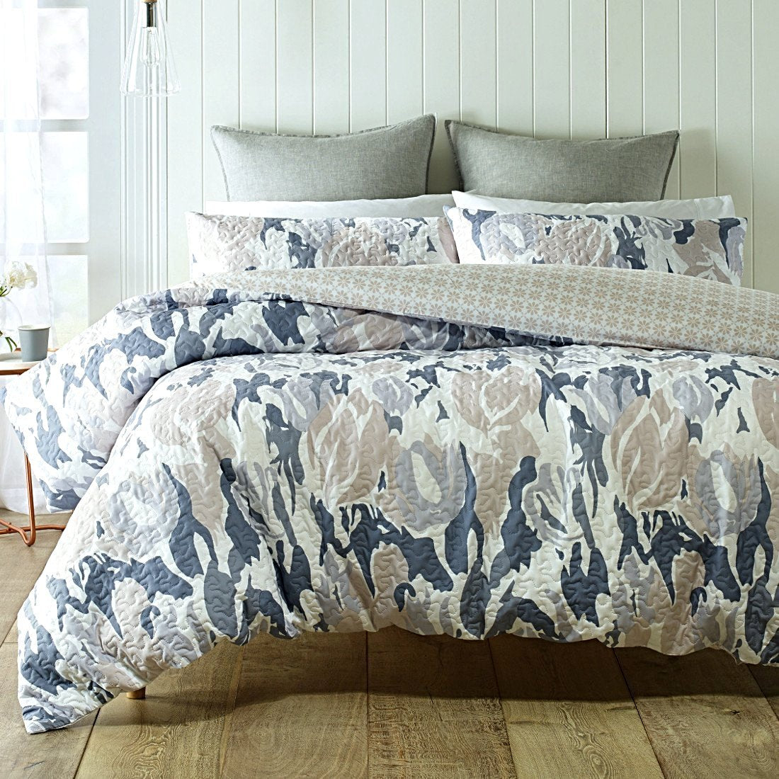 Reversible, Minimal, understated colors like white, grey and beige feature on this quilt cover set.