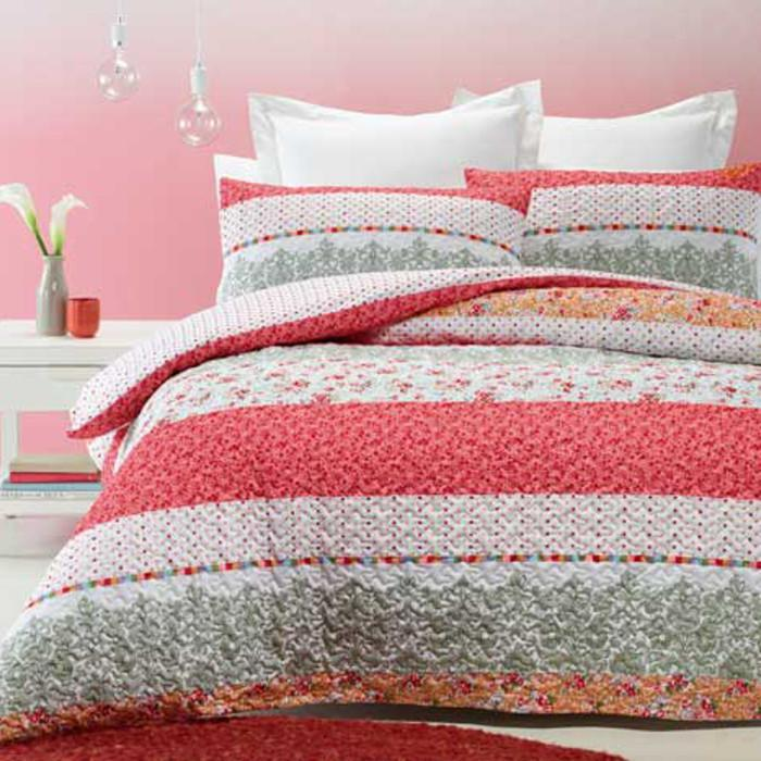 Quilted effect, modern duvet cover set in white, red and pink print. Reversible.