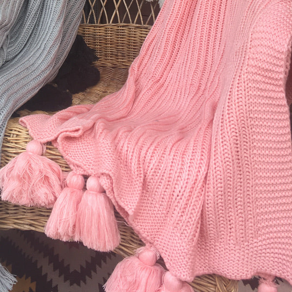 Pink knitted texture blanket with chunky tassels, throw