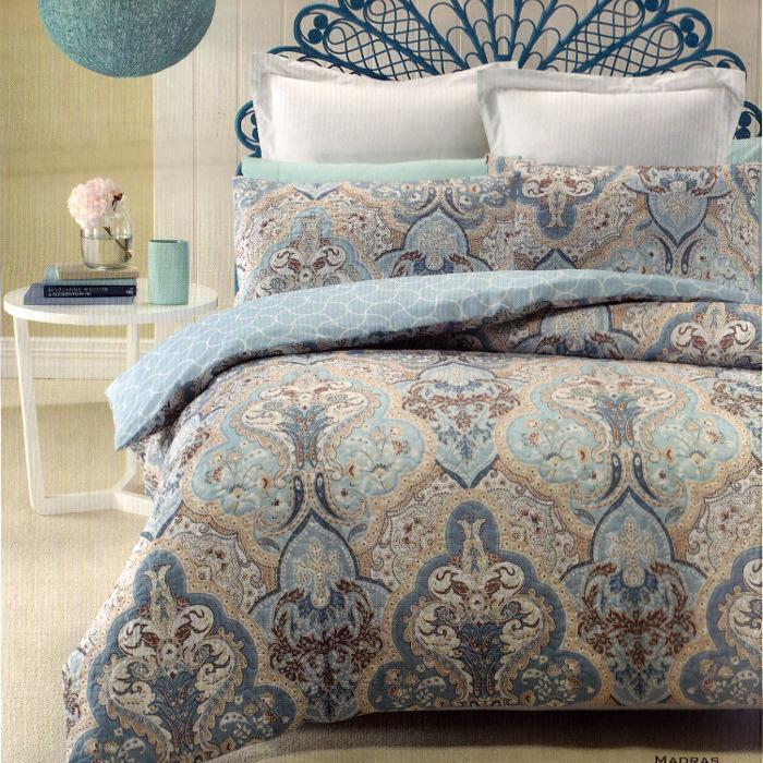 Reversible, Classic, soft colors like white, blue and beige feature on this quilt cover set.