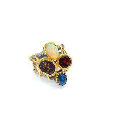 One Of A Kind Ethiopian Opal Spectroltie And Garnet Ring