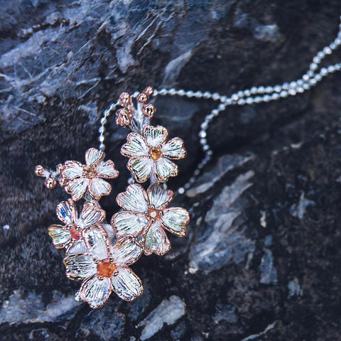 Magic 925 silver floral cluster pendant + chain with orange sapphire