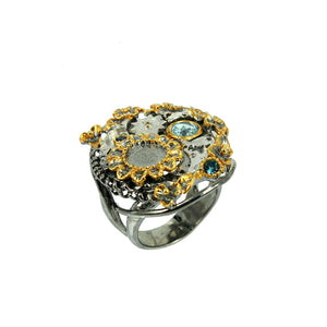 SteamPunk - 925 Sterling Silver Ring, Decorated with Blue Topaz and Blue Sapphires, Plated with 3 Micron 22K Yellow Gold and Grey Ruthenium