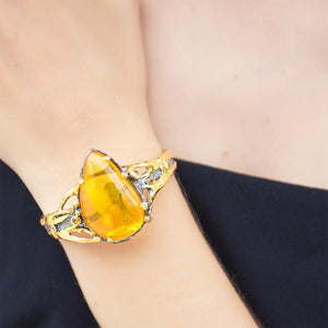 Silver bangle bracelet with big amber, gold accents & orange sapphire