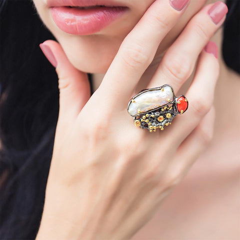 Unique designer silver ring with baroque pearl, red coral, sapphires