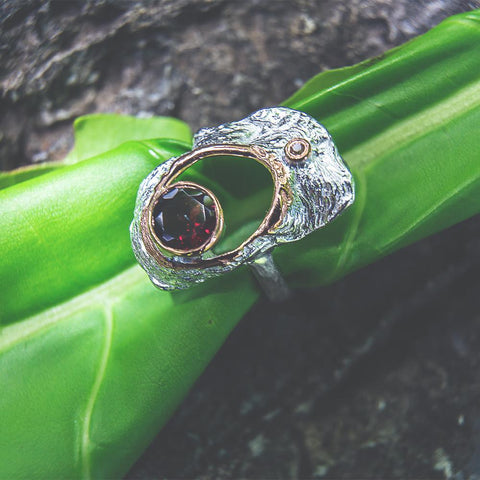 Fanciful garnet ring, hammered surface, hole in center, 925 silver