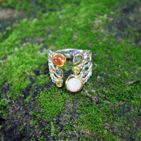 Opened gemstone silver ring with champagne opal and orange sapphire