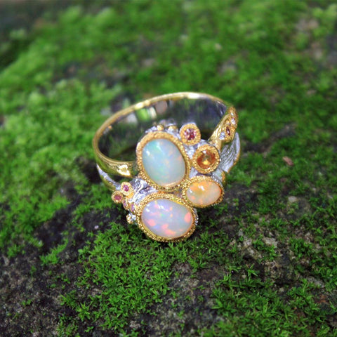 Ethiopian Opal sterling silver gemstone ring with small orange sapphires