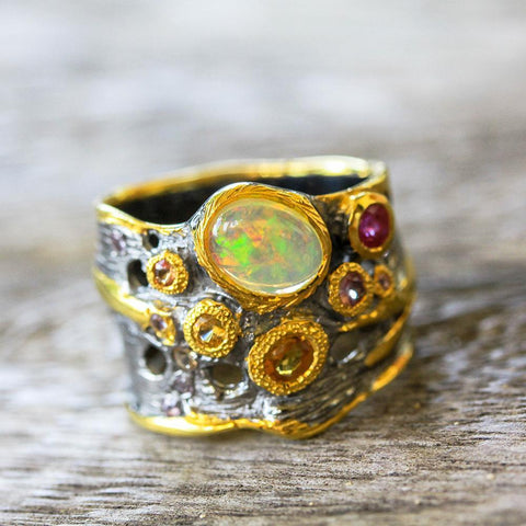 Designer sterling silver ring with Ethiopian opal and fancy sapphires