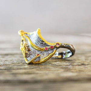 Sterling silver leaf ring with golden edges and small red sapphires