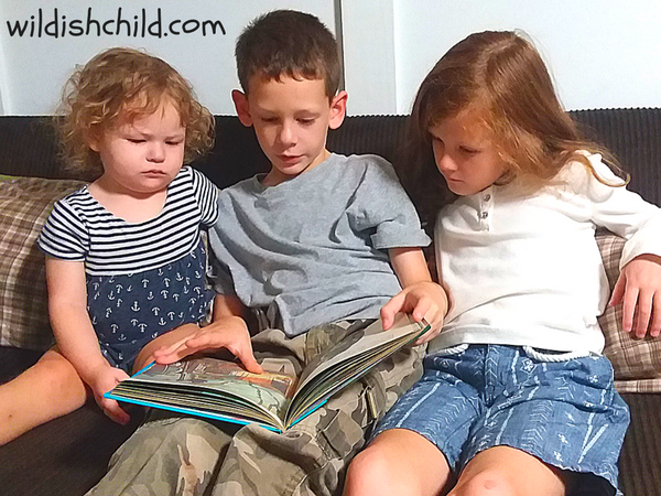 wildish child favorite book friday berenstain bears and the spooky old tree kids reading on couch baby concentrating