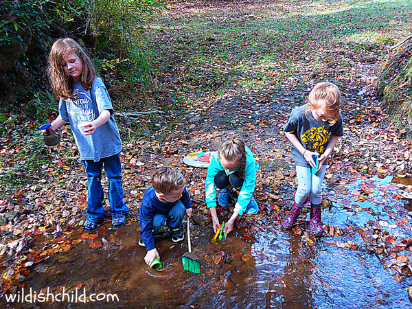 wildish child a charlie brown thanksgiving party kids washing dishes in creek