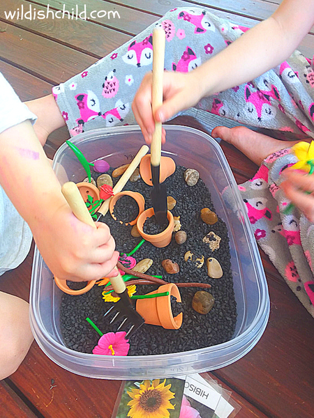 wildish child flower sensory bin using tools