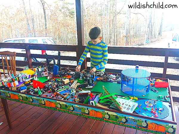 wildish child the unusual place we store legos boy with train table
