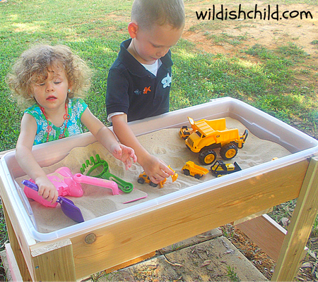 wildish child wacky lab children playing with sand table