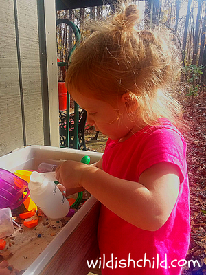wildish child wacky lab little girl measuring sand into container