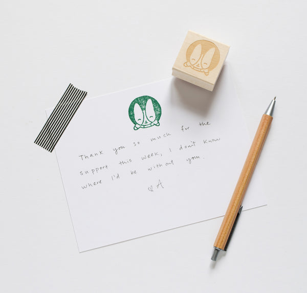 corgi stamp popping out of circle in green ink used as a note card