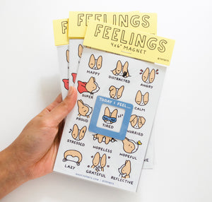 packaged photo of feelings magnet of a chart of feelings with cute corgi expressions ranging from happy to reflective to angry to calm