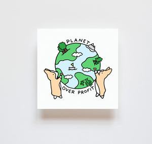 drawing of two corgis with a heart in their hands holding up the earth in between them, that depicts its land, trees, cacti, mountains, and the blue sea. text circles the earth reading planet over profit