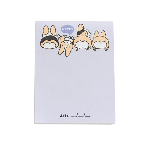 blank notepad that has a light purple background with four corgis across the top and a quote bubble reads 'notes' and a spot for the date