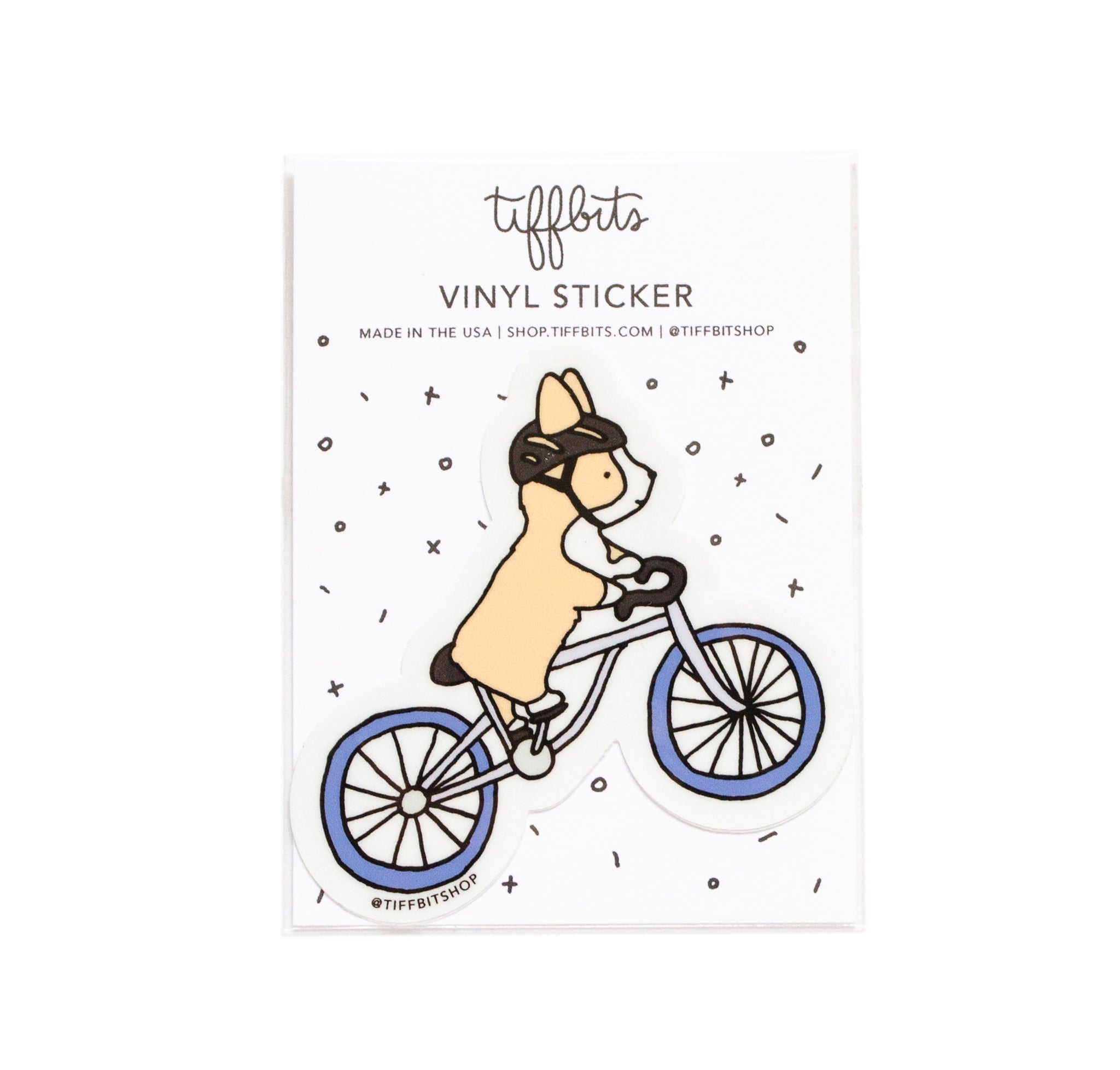 corgi riding bicycle sticker in packaging
