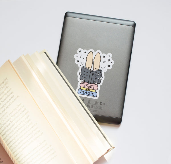 sticker on e-reader and book