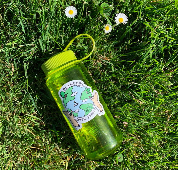 sticker on water bottle in the grass