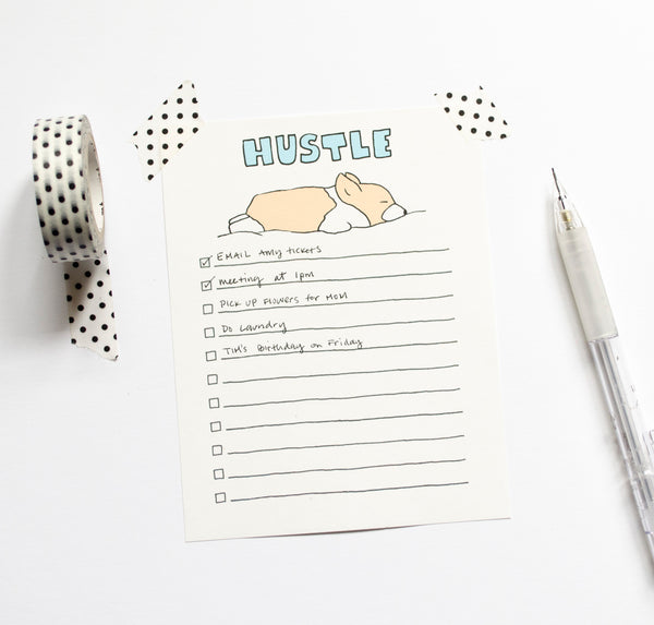 hustle notepad with corgi sleeping styled photo
