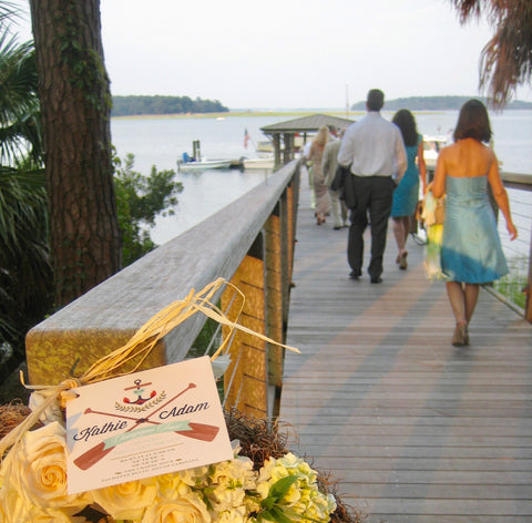 Wedding Guests walking down dock to Lady Grace Reception at Palmetto Bluff