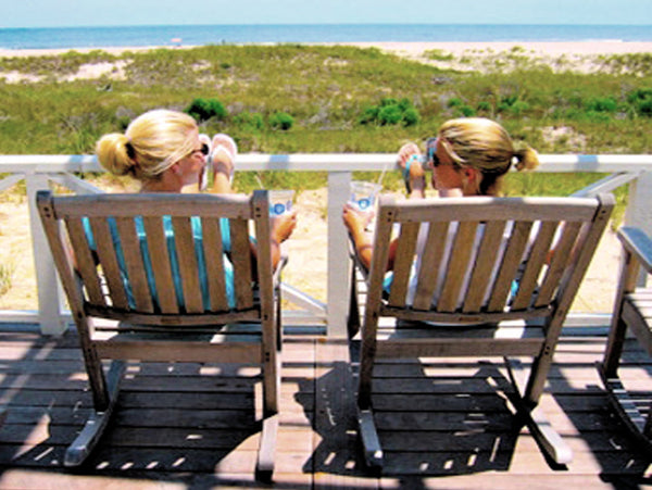 Two Ladies Sitting on Deck at Beach