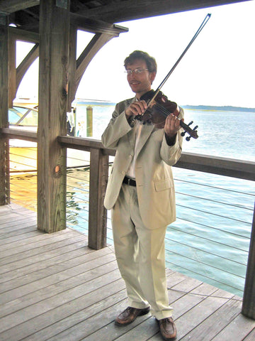 Violinist lead guests to Lady Grace Reception at Palmetto Bluff