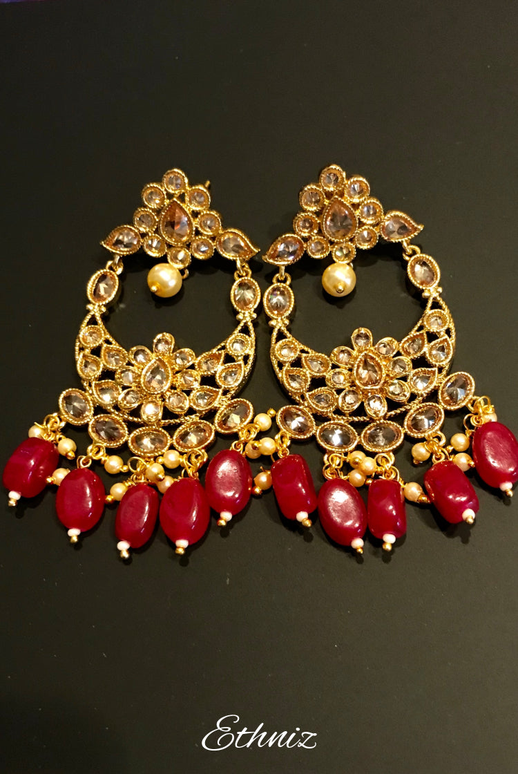Red dangling earring with White stone