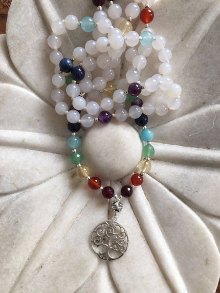 Mala from the Himalayas with moon stone and chakra beads