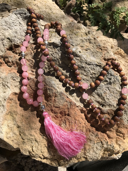 Mala from the Himalayas with real rose quartz semi precious gemstone and the sandel wood beads  , silver beads and silk tassle