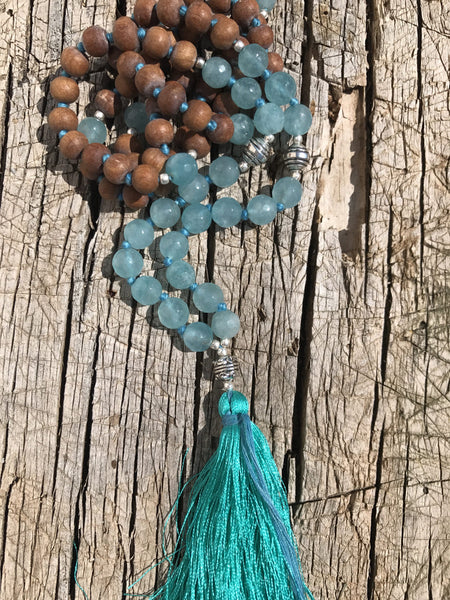 Mala  jewellery from the Himalayas with turquoise crystal Quartz and the sandekwood , silver beads and silk tassle