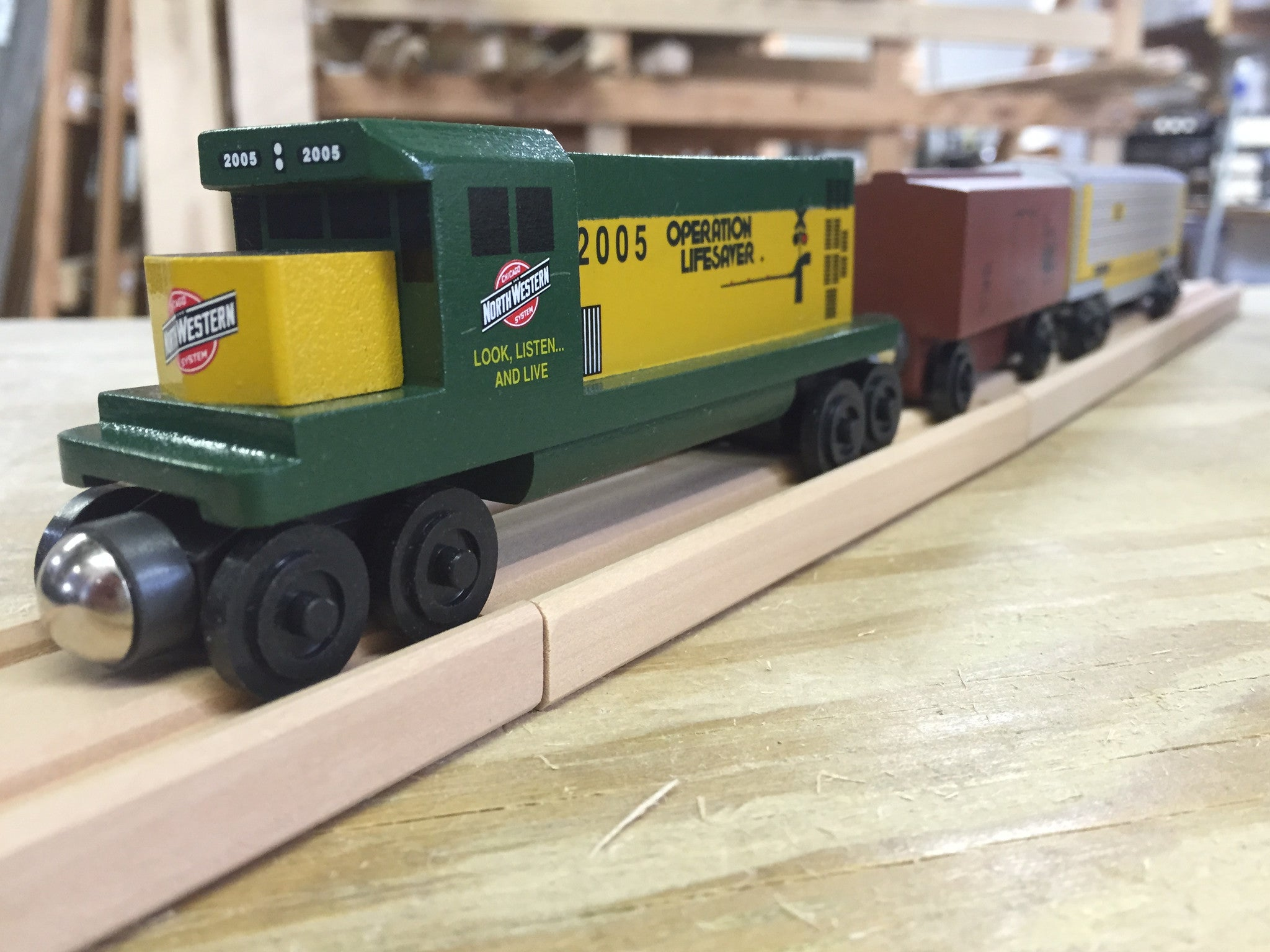 Whittle Shortline Railroad Chicago and Northwestern GP-38 Diesel Engine Wooden Toy Train with other Whittle Trains
