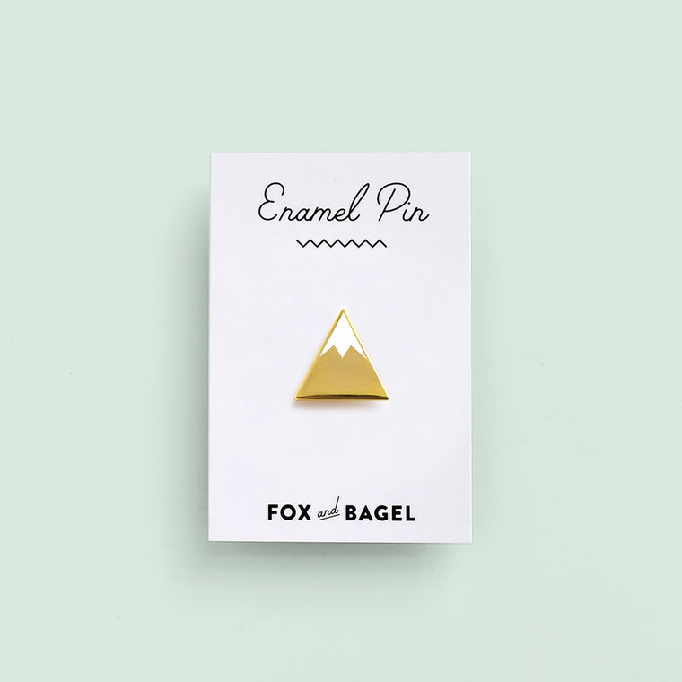 Snow-capped mountain gold hard enamel pin by Fox & Bagel.