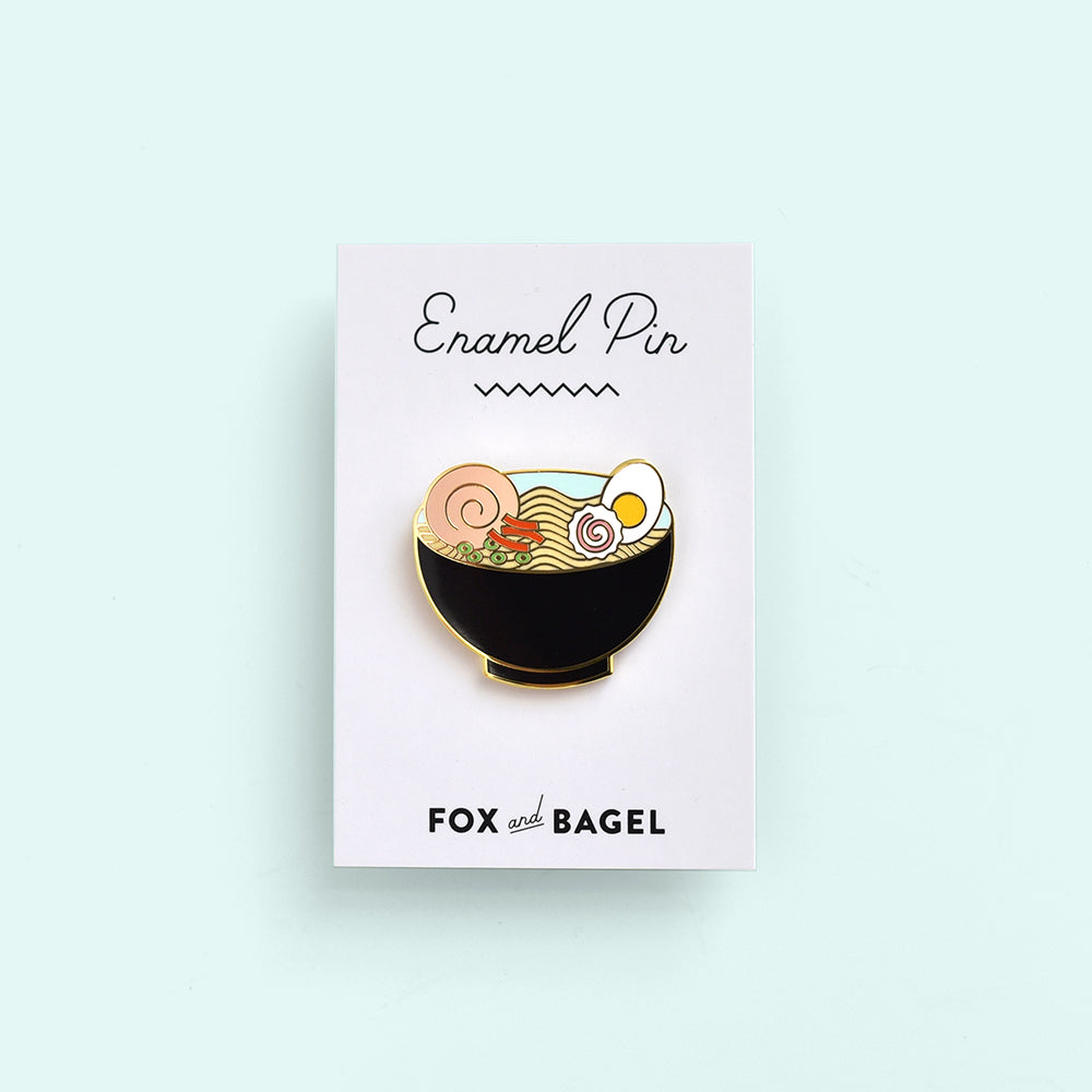 Japanese ramen soup noodles with cha shu, egg, kamaboko. Hard enamel pin by Fox & Bagel.