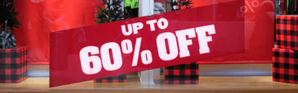 "A picture of a store front that says ""UP TO 60% OFF""."