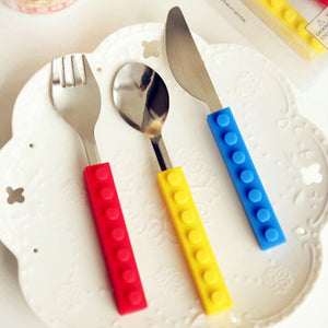 Lego bricks silicone and stainless steel, including a Fork, Spoon, and knife.