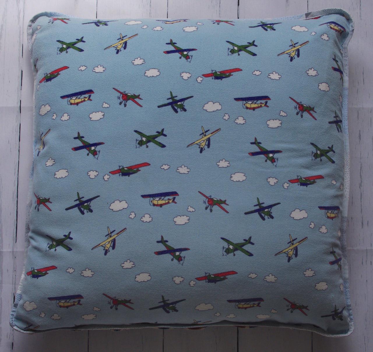 eco-friendly-sustainable-repurposed-handmade-home-decor-floor-pillow-airplanes-boho-floor-pillow-front