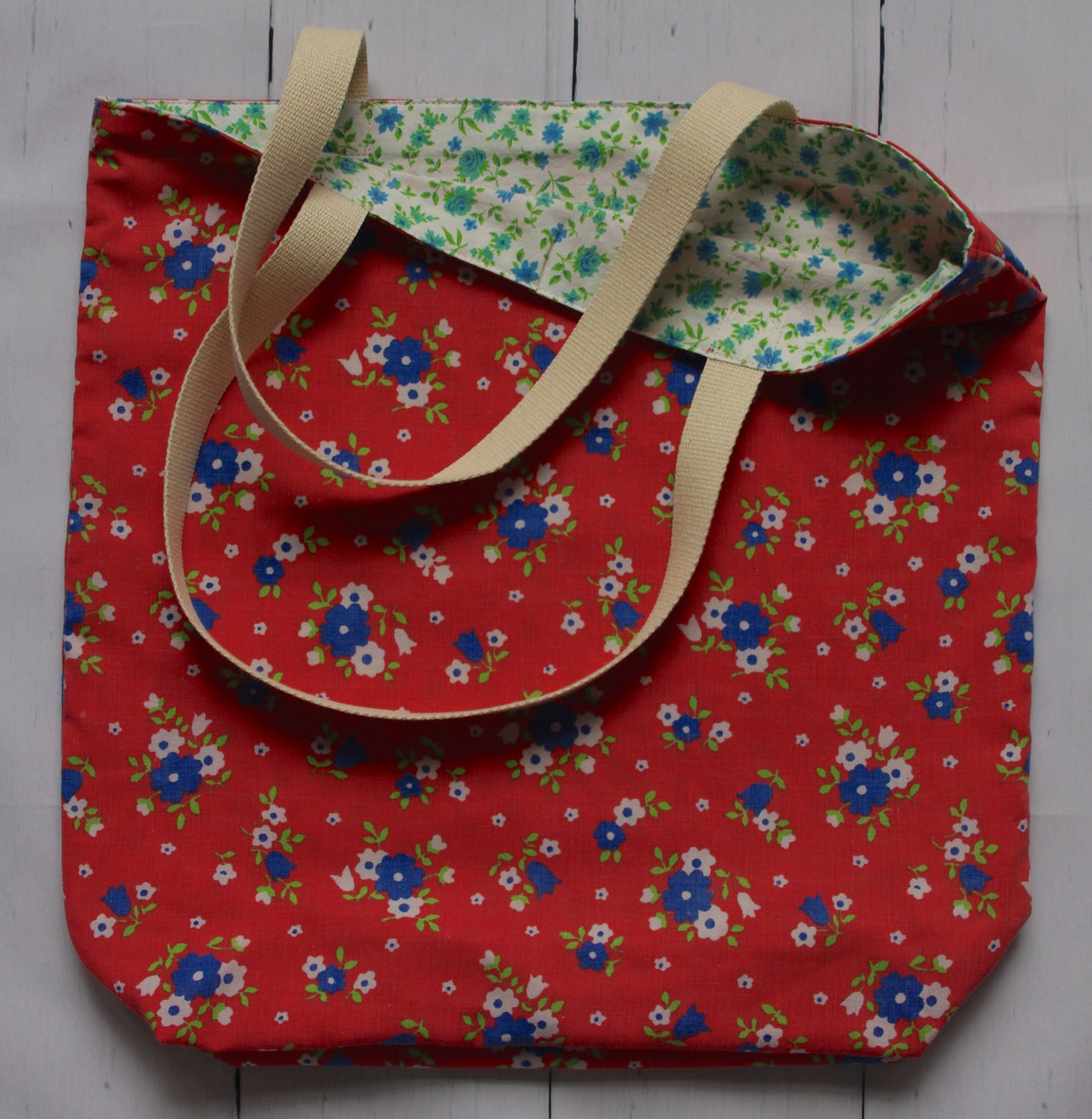 ditzy-floral-red-hilary-hope-tote-bag-exterior-with-glimpse-of-interior