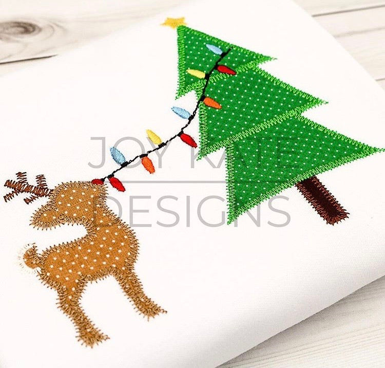 Reindeer Decorating Tree