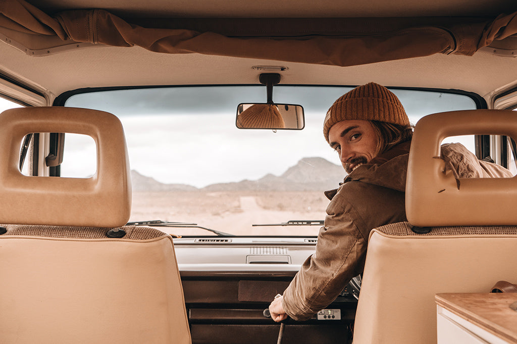 Will & Bear co-founder Alexander Knorr drives vintage van wearing Levi Mustard Beanie